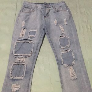 Denim - A pair of ripped blue jeans
